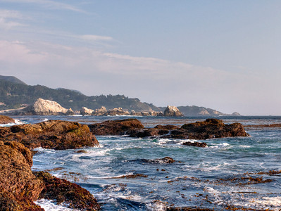 Was itching to go somewhere and have a proper photo shoot day, so I looked up things to do in Carmel and happened upon a place called Point Lobos State Reserve. Saw some cool photos on Flickr, so that's where we went last Saturday. We didn't get too far away from where we parked, but we had an awesome couple hours or so exploring the rock formations and tide pools near the spot we stopped. I think it was somewhere near Weston Beach that we spent all our time. Point Lobos is a huge park, so we barely, barely even scratched the surface of what we could do there. We'll definitely go back again sometime and get there earlier in the day so we can fit more activities in, but I was pretty content with the time we spent there that day.  I took a lot of photos of tide pools and other stuff facing away from the ocean. This ocean-view photo is meant to help balance things out. :)